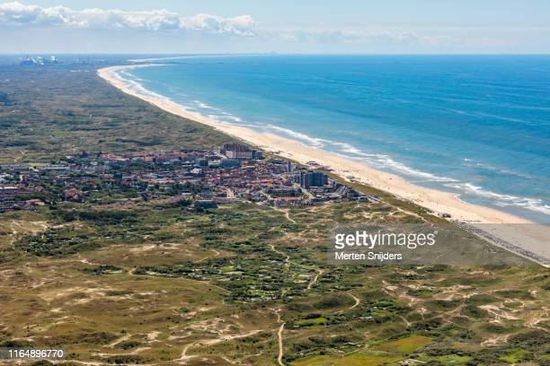 aerial of city, dunes and beach at egmond aan zee - national recreation area stock pictures, royalty-free photos & images