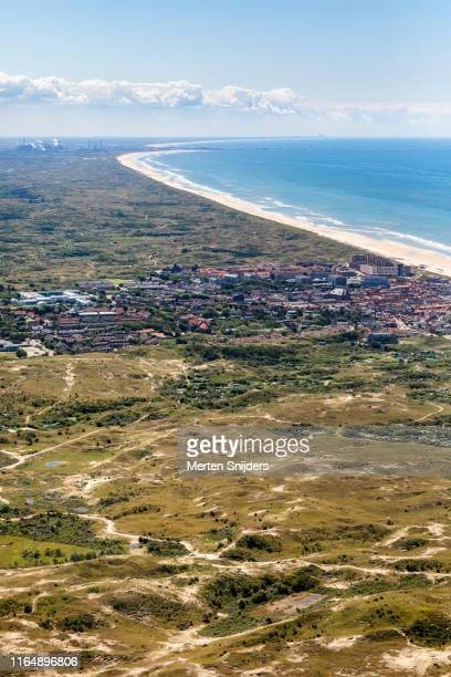 aerial of city, dunes and beach at egmond aan zee - merten snijders stock pictures, royalty-free photos & images