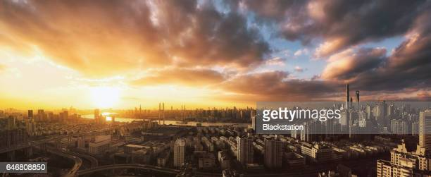 Aerial of City of Shanghai at sunset looking west