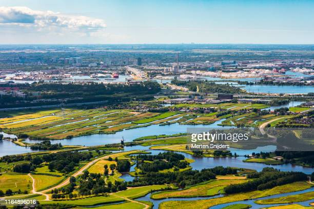 aerial of coentunnel, amsterdam sloterdijk, noord and houthavens behind twiske recreational park - merten snijders stock pictures, royalty-free photos & images