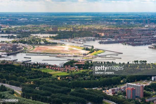 aerial of construction plane at sluisbuurt zeeburgereiland - merten snijders stock pictures, royalty-free photos & images
