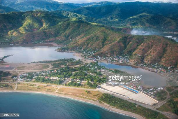 aerial of dili, east timor, southeast asia, asia - llanura costera fotografías e imágenes de stock