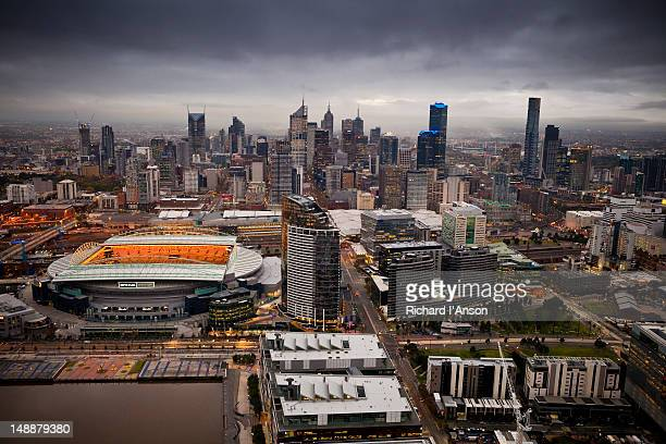 aerial of docklands and etihad stadium and central business district. - docklands stadium melbourne stock pictures, royalty-free photos & images