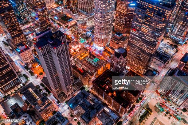 aerial of downtown los angeles california at night - centro della città foto e immagini stock