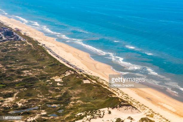 aerial of dunes and beach at egmond aan zee - merten snijders stock pictures, royalty-free photos & images
