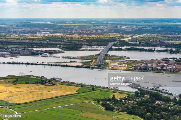 aerial of durgerdam and ijburg divided by zeeburgertunnel - merten snijders stock pictures, royalty-free photos & images