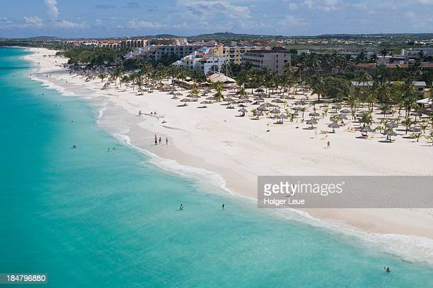 aerial of eagle beach and low-rise hotels - oranjestad stockfoto's en -beelden