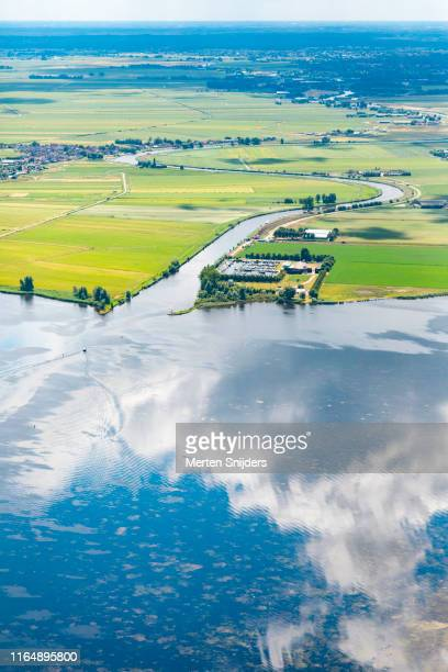 aerial of eemmeer with cloud reflections - merten snijders stock pictures, royalty-free photos & images
