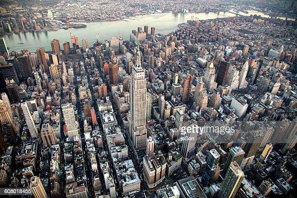 aerial of empire state building  and manhattan - new york city stock pictures, royalty-free photos & images