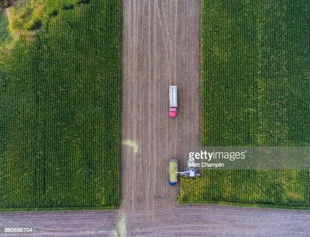 Aerial of Farm Equipment Harvesting Corn