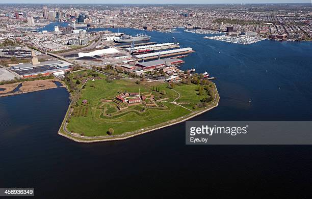 aerial of fort mchenry at entrance to baltimore inner harbor - fort mchenry stock photos and pictures