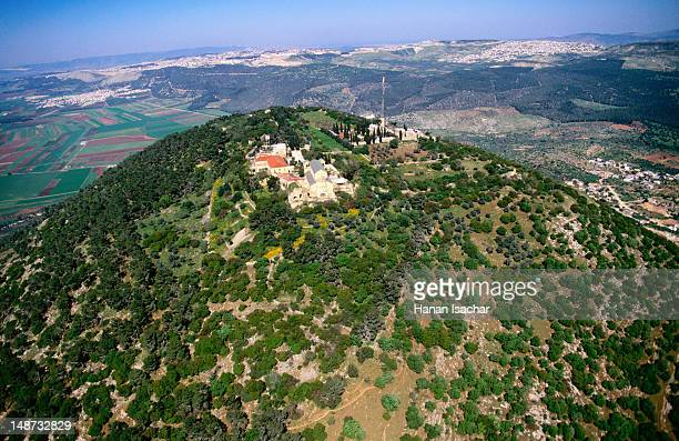 Aerial of Franciscan Church of Transfiguration (left) and Greek Orthodox church atop Mount Tabor with Nazareth in background.