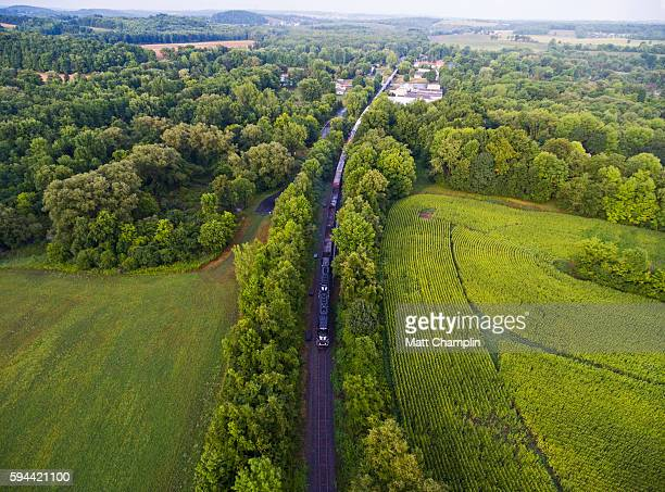 aerial of freight train traveling along tracks - weather balloon stock pictures, royalty-free photos & images