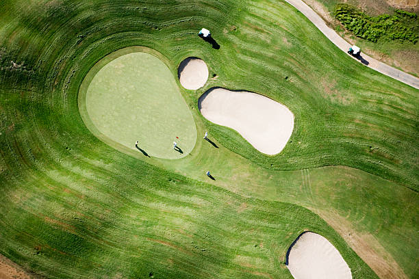 Aerial of golfers on green of Tierra del Sol Golf Course.