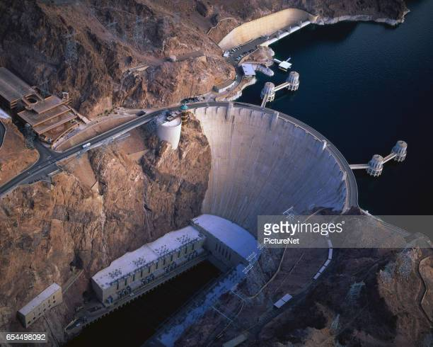 aerial of hoover dam - hoover dam stock photos and pictures