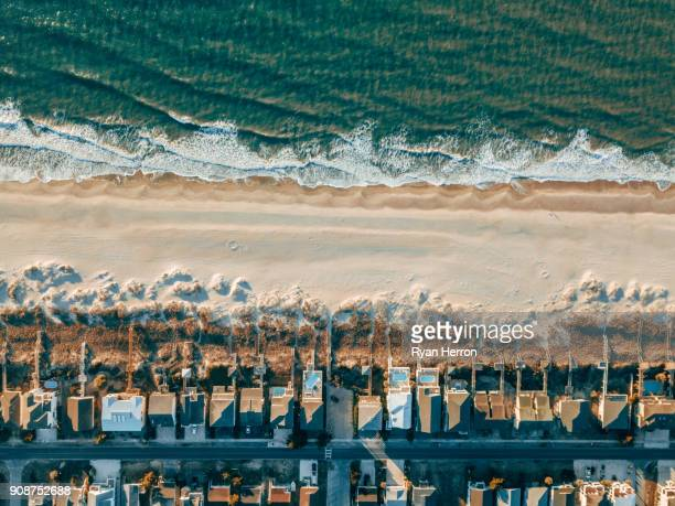 aerial of houses on the beach - coastline stock pictures, royalty-free photos & images