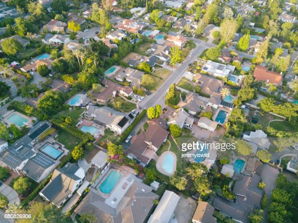 aerial of houses - housing difficulties stock pictures, royalty-free photos & images