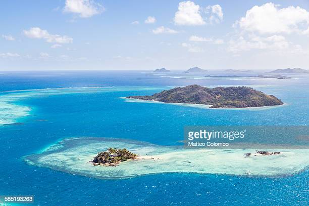Aerial of island with tourist resort, Fiji