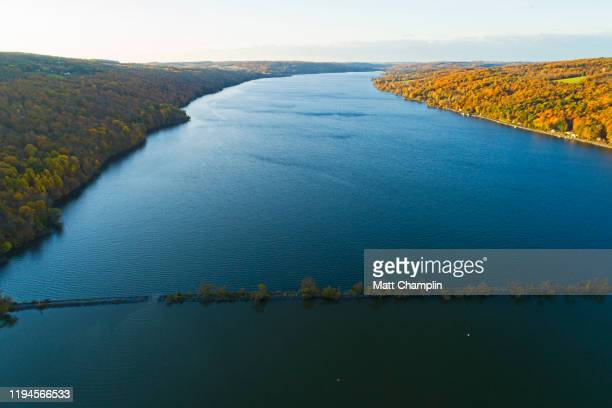 aerial of lake in autumn - finger lakes stock pictures, royalty-free photos & images