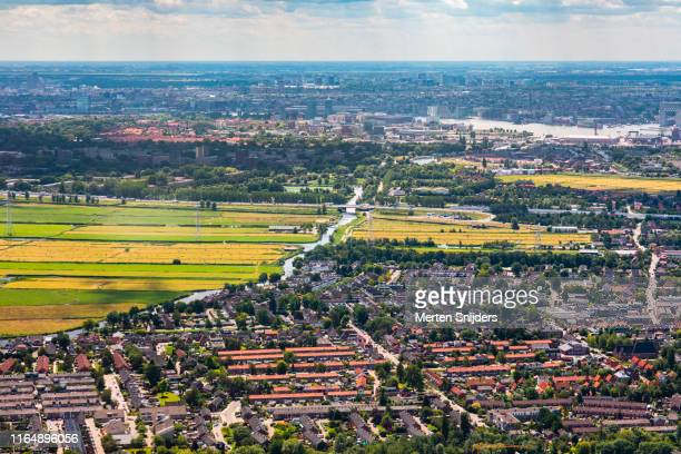 aerial of landsmeer and amsterdam - merten snijders stock pictures, royalty-free photos & images
