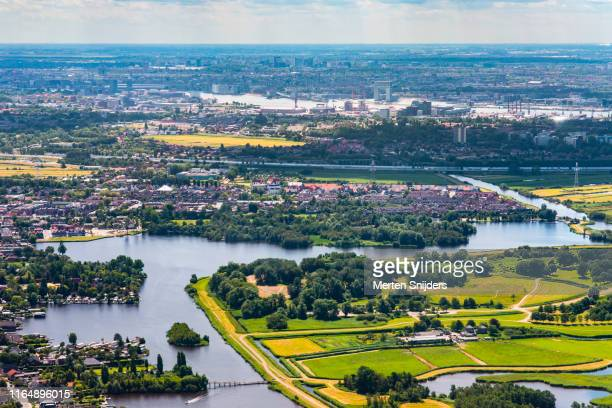 aerial of landsmeer twiske and amsterdam noord and houthavens - merten snijders stock pictures, royalty-free photos & images