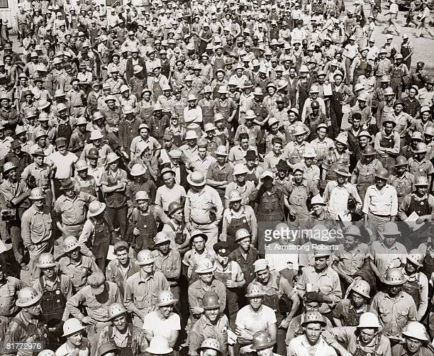aerial of large group of men tva construction workers wearing hard hats. - great depression stock pictures, royalty-free photos & images