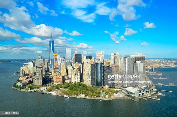 aerial of lower manhattan with financial district, freedom tower, wtc, brooklyn bridge, hudson river and east river, nyc, - parque battery fotografías e imágenes de stock