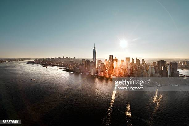 aerial of manhattan, nyc at sunrise - new york city stock-fotos und bilder