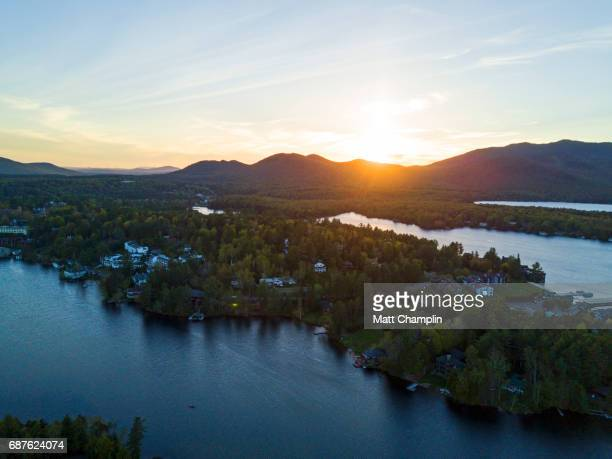 aerial of mirror lake and lake placid in the adirondacks - mirror lake stock pictures, royalty-free photos & images