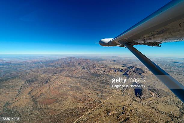 aerial of namibia, erongo plateau below, the spitzkoppe in distance. - erongo stock photos and pictures