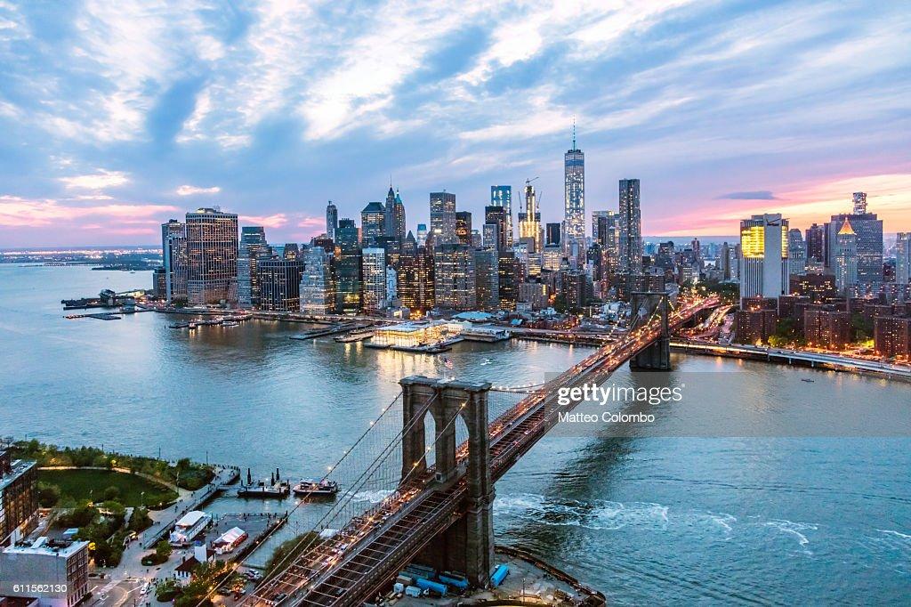 Aerial of New York city and Brooklyn bridge at dusk : Stock Photo