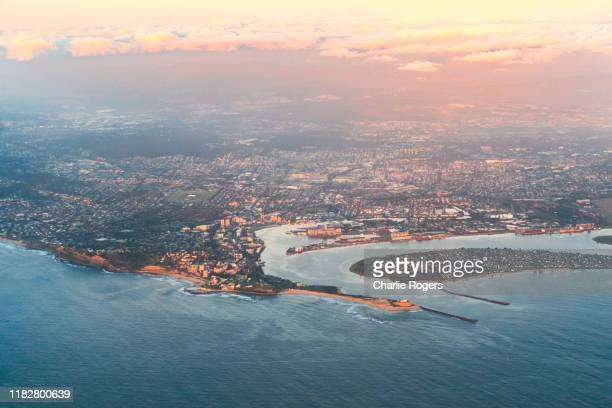 aerial of newcastle and newcastle harbour, new south wales, australia - newcastle new south wales stock pictures, royalty-free photos & images