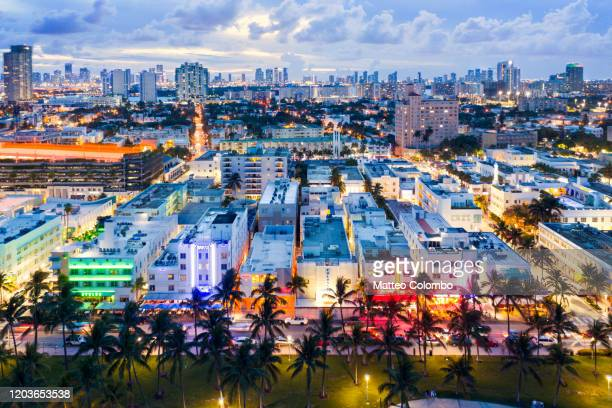 aerial of ocean drive and miami downtown at dusk, florida - south beach stock pictures, royalty-free photos & images