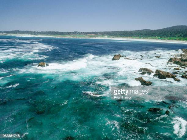 aerial of ocean waves - pebble beach california stock pictures, royalty-free photos & images