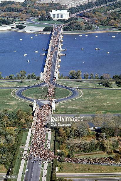 Aerial of peace demonstrators marching across Memorial Bridge in protest of the war in Vietnam