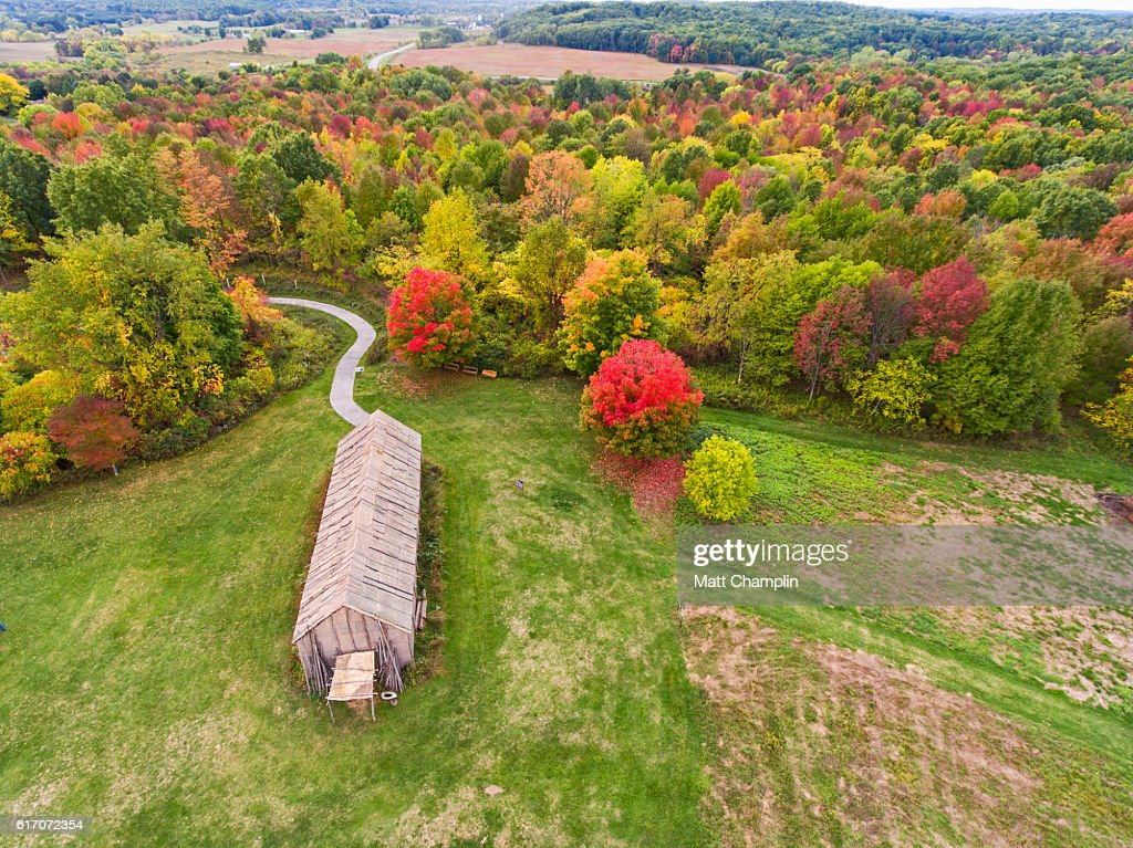 Aerial of reconstructed Iroquois Longhouse : Stock Photo