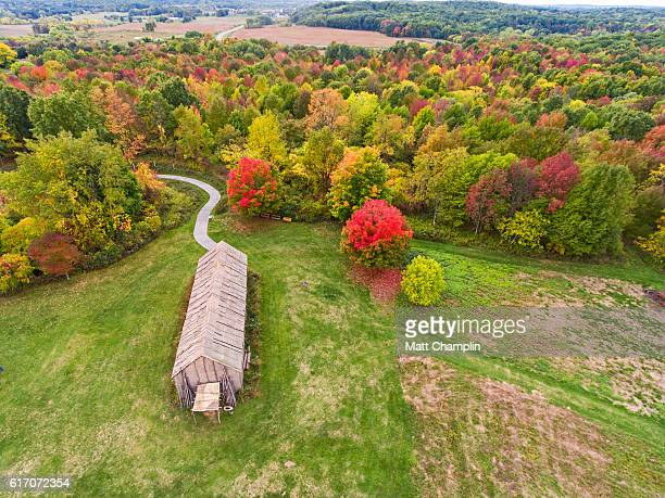 aerial of reconstructed iroquois longhouse - iroquois stock photos and pictures