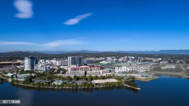 aerial of residential and commercial buildings belconnen from lake ginninderra - australian capital territory stock pictures, royalty-free photos & images