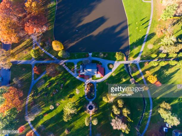 aerial of residential neighborhood during a beautiful autumn afternoon - lake auburn - fotografias e filmes do acervo