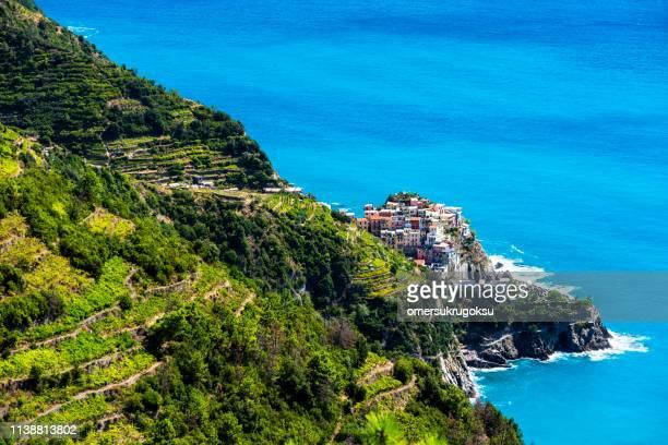 aerial of riomaggiore village in cinque terre, la spezia, italy - liguria foto e immagini stock