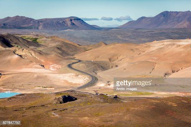 aerial of road and mountains. namaskard- geothermal volcanic area, northern iceland - country geographic area stock pictures, royalty-free photos & images
