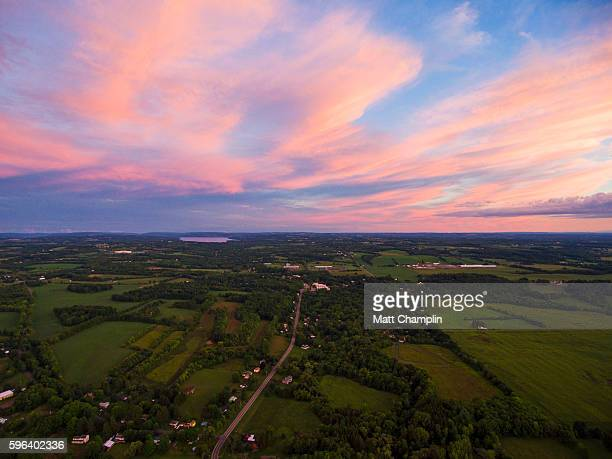 aerial of rural farmlands during summer sunset - finger lakes stock pictures, royalty-free photos & images