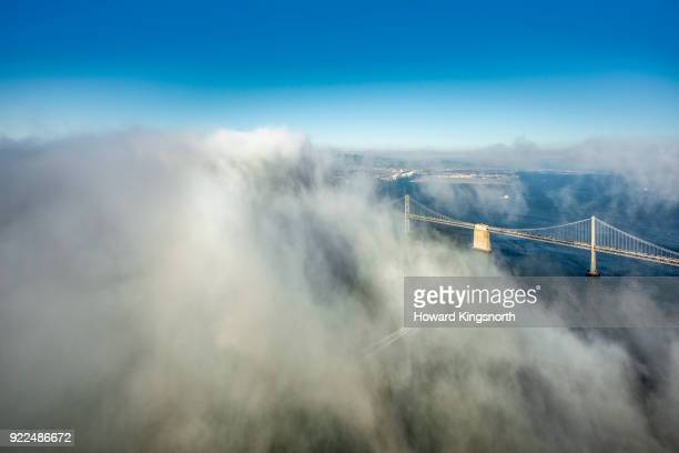 aerial of san francisco bay area with clouds - suspension bridge stock photos and pictures