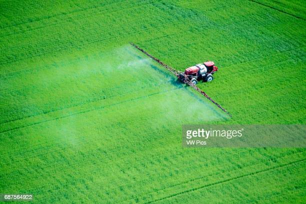 Aerial of spray application in green agricultural field on the eastern shore of Maryland USA