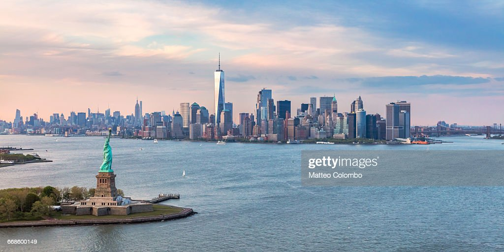 Aerial of Statue of Liberty and Manhattan skyline : Stock Photo