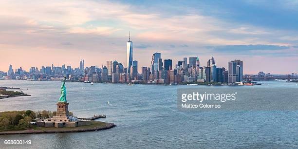 aerial of statue of liberty and manhattan skyline - statue of liberty stock pictures, royalty-free photos & images