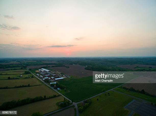 aerial of sunset over dairy farm - lake auburn - fotografias e filmes do acervo