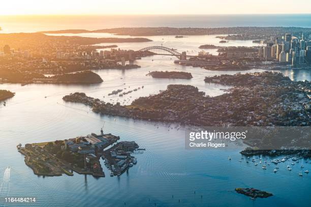 aerial of sydney harbour at sunrise - sydney stock pictures, royalty-free photos & images
