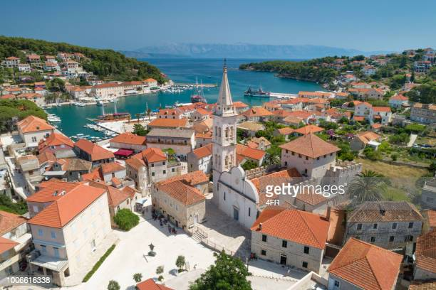 aerial of the beautiful town jesla with the famous st. mary's church, island hvar, croatia - hvar stock photos and pictures