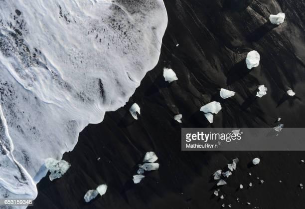 Aerial of the Icebergs in the black sand beach in Jokulsarlon
